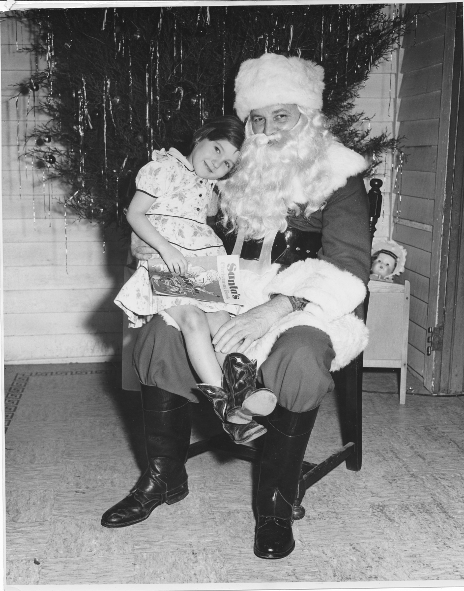 Betsy with Bill Gaither, who worked as Santa every Christmas.jpg