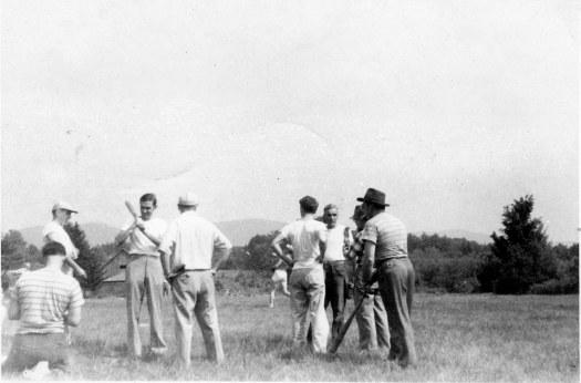 Breadloaf '48 Ted facing camera, John Ciardi with bat, AG left with bat